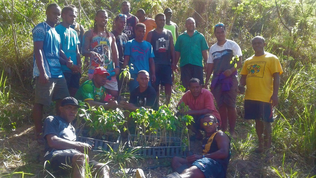 Community Youth Group help establish Agroforestry plot.