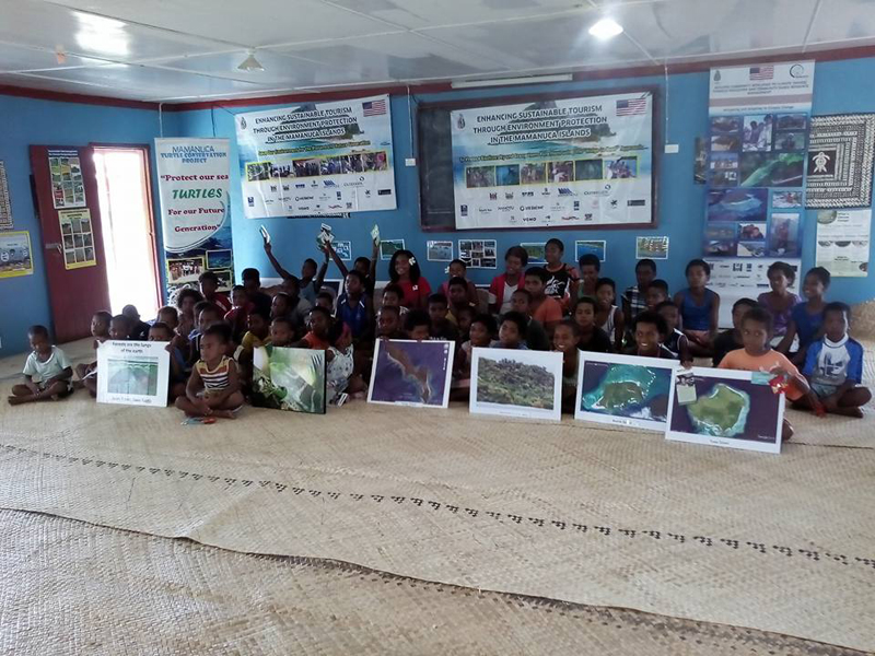 Village children learn about Maintaining Biodiversity and Healthy Ecosystems